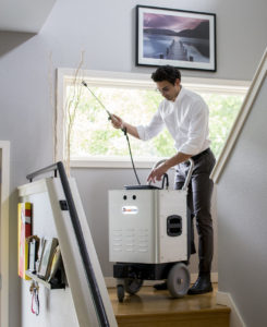 Inspector using the Instascope machine to detect mold in a home